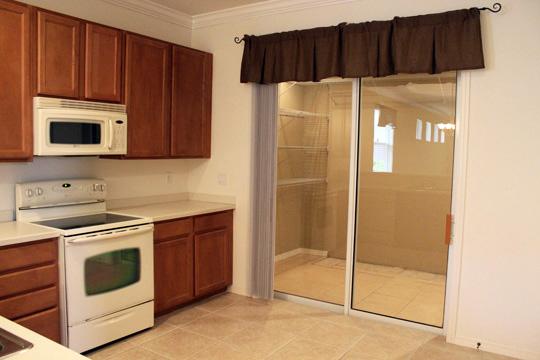 Kitchen & Sunroom Before